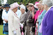 Queen Elizabeth II meets members of the Glasgow Wrens Association during the annual garden party at the Palace of Holyroodhouse on July 4, 2017  in Edinburgh, Scotland.