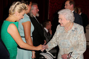 Queen Elizabeth II meets actor Sheriden Smith (L) during her reception to celebrate the patronages & affiliations of the Earl and Countess of Wessex at Buckingham Palace on February 10, 2015 in London, England