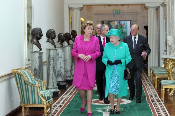 Queen Elizabeth II Queen Elizabeth II (R), President Mary Mc Aleese, Prince Philip The Duke of Edinburgh and Dr Martin Mc Aleese walk along the Francini corridor lined by the bronze busts of former Presidents in Aras An Uachtarain on May 17, 2011 in Dublin,Ireland. The Queen's visit, accompanied by The Duke of Edinburgh, is the first by a monarch since 1911. An unprecedented security operation is taking place with much of the centre of Dublin turning into a car free zone. Republican dissident groups have made it clear they are intent on disrupting proceedings.