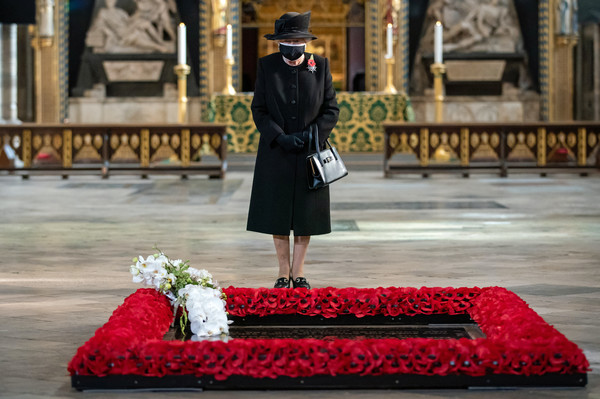 The Queen Marks The Centenary Of The Burial Of The Unknown Warrior [marks the centenary of the burial of the unknown warrior,fashion,street fashion,headgear,outerwear,fur,coat,robe,elizabeth ii,queen,nana kofi twumasi-ankrah,serviceman,unknown warrior,grave,flowers,behalf,westminster abbey,tradition]