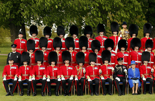 The Queen Presents New Colours To The 1st Battalion, Welsh Guards [queen presents new colours to the 1st battalion welsh guards,photograph,team,uniform,marching,event,musician,crew,elizabeth ii,c,colours,windsor castle,united kingdom,london,1st battalion welsh guards]