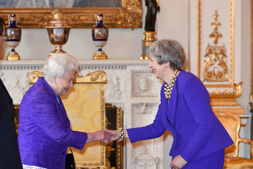 Queen Elizabeth II Theresa May Queen Elizabeth II Marks The Fiftieth Anniversary Of The Investiture Of The Prince Of Wales