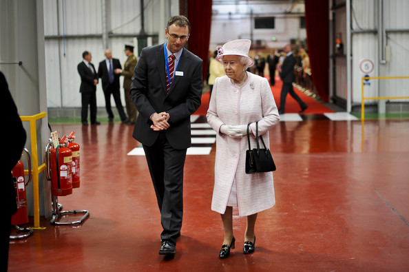 Queen Elizabeth II is shown around the factory during a visit to International Greetings UK Ltd at the Penallta Industrial Estate in Ystrad Mynach during her visit to south west Wales on April 30, 2014 in Ystrad Mynach, Wales.