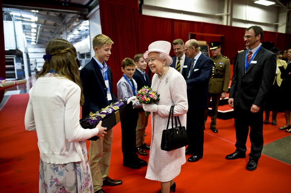 Queen Elizabeth II is presented with gifts following a visit to International Greetings UK Ltd at the Penallta Industrial Estate in Ystrad Mynach during her visit to south west Wales on April 30, 2014 in Ystrad Mynach, Wales.