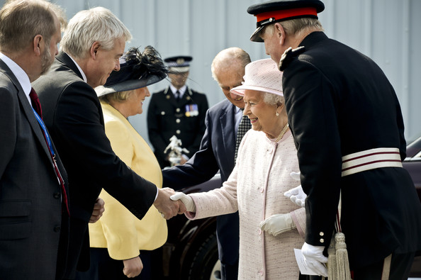 Queen Elizabeth II meets Wales' First Minister Carwyn Jones during her visit to south west Wales on April 30, 2014 in Hengoed, Wales.