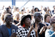 """Oberon KA Adjepong, Lupita Nyong'o and Moses Sumney attends the """"Queen Of Glory"""" premiere during the 2021 Tribeca Festival at Pier 76 on June 15, 2021 in New York City."""