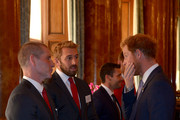 Prince Harry speaks with England Rugby Union head coach Stuart Lancaster (left) and England captain Chris Robshaw (second left) during a reception to mark the Rugby World Cup 2015 at Buckingham Palace on October 12, 2015 in London, United Kingdom.