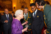 Queen Elizabeth II and Prince Philip, Duke of Edinburgh (left) with South Africa's Bryan Habana (third right),  Australia's Henry Speight and South Africa's Victor Matfield (right) at a Rugby World Cup reception at Buckingham Palace on October 12, 2015 in London, United Kingdom.