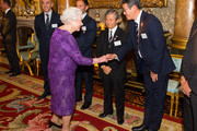 Queen Elizabeth II meets Chairman of Japan Rugby Football Union Noriyuki Sakamoto (centre) and Special Director of Japan RFU Naoki Maeda at a Rugby World Cup reception at Buckingham Palace on October 12, 2015 in London, United Kingdom.