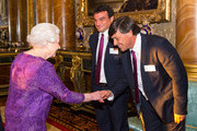 Queen Elizabeth II meets Argentina Rugby Union Captain Agustin Creevy (centre) and Argentina head coach Daniel Hourcade (right) at a Rugby World Cup reception at Buckingham Palace on October 12, 2015 in London, United Kingdom.