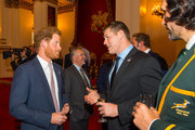Prince Harry (left) meets USA's Hayden Smith (centre) and South Africa's Victor Matfield (right) at a Rugby World Cup reception at Buckingham Palace on October 12, 2015 in London, United Kingdom.