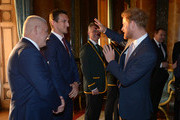 Prince Harry meets Wales' Rugby Union Captain Sam Warburton (second left) and Wales' head coach Warren Gatland (left) at a reception at Buckingham Palace to welcome Rugby World Cup stars on October 12, 2015 in London, United Kingdom.