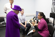 Queen Elizabeth II meeting Vinnari Shah, Volunteer, as she opens the new premises of the Royal National ENT and Eastman Dental Hospital on February 19, 2020 in London, England.