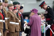 Queen Elizabeth II (C) greets members of The Royal Welsh as she attends a review and presents Leeks to The Royal Welsh to mark St David's Day at Lucknow Barracks on March 3, 2017 in Tidworth, England.