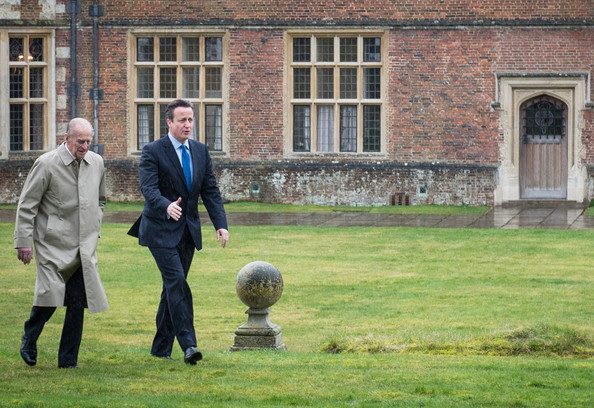 Prince Philip, Duke of Edinburgh and Prime Minister David Cameron walk in the grounds of Chequers where they had lunch with the Queen Elizabeth II and Samantha Cameron, on February 28, 2014 near Aylesbury, England. It is the first time the Queen has visited the PM's official country residence in Buckinghamshire since 1996.