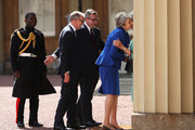 Prime Minister Theresa May and husband Philip May are greeted by Rt Hon Edward Young, private secretary to the Queen, Major Nana Twumasi-Ankrah, Household Cavalry Regiment and Lady Susan Hussey, the Queen's lady in waiting as they arrive at Buckingham Palace on July 24, 2019 in London, England. The British monarch remains politically neutral and the incoming Prime Minister visits the Palace to satisfy the Queen that they can form her government by being able to command a majority, holding the greater number of seats, in Parliament.  Then the Court Circular records that a new Prime Minister has been appointed.