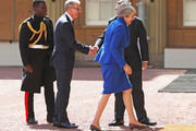 Prime Minister Theresa May and husband Philip May are greeted by Rt Hon Edward Young, private secretary to the Queen, and Major Nana Twumasi-Ankrah, Household Cavalry Regiment as they arrive at Buckingham Palace on July 24, 2019 in London, England. The British monarch remains politically neutral and the incoming Prime Minister visits the Palace to satisfy the Queen that they can form her government by being able to command a majority, holding the greater number of seats, in Parliament.  Then the Court Circular records that a new Prime Minister has been appointed.