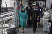 Her Majesty The Queen visited HMS Sutherland in the West India Dock, London.  The Ship will be celebrating the 20th anniversary of her Commissioning.. Her Majesty was greeted by Commander Andrew Canale, MVO, RN. The Queen  entered a marquee where a Reception for the Ship's Company, families, former Commanding Officers and affiliates took place..The Queen then embarked  HMS Sutherland, and met a number of personnel on the upper deck, and had lunch.. The Queen, accompanied by Commander Canale, a former Equerry in Waiting to Her Majesty (2012-15),  joined the Ship's Company on the Flight Deck for a group photograph..Picture Arthur Edwards