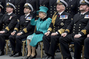Queen Elizabeth II reacts as she joins the Ship's Company on the Flight Deck for a group photograph as she visits HMS Sutherland in the West India Dock as the ship celebrates its 20th anniversary of her Commissioning on October 23, 2017 in London, England.