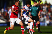 Ji-Sung Park (R) of Queens Park Rangers holds off the challenge of Aaron Ramsey (L) of Arsenal during the Barclays Premier League match between Queens Park Rangers and Arsenal at Loftus Road on May 04, 2013 in London, England.