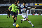 Ji-Sung Park of Queens Park Rangers is closed down by Matthew Lowton of Aston Villa during the Barclays Premier League match between Queens Park Rangers and Aston Villa at Loftus Road on December 1, 2012 in London, England.
