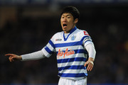 Ji-Sung Park of Queens Park Rangers directs his team during the Barclays Premier League match between Queens Park Rangers and Aston Villa at Loftus Road on December 1, 2012 in London, England.