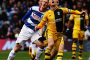 Scott Parker (R) of Fulham is challenged from behind by Sebastian Polter (L) of Queens Park Rangers during the Sky Bet Championship match between Queens Park Rangers and Fulham at Loftus Road on February 13, 2016 in London, United Kingdom.