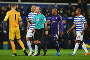 Referee Mike Dean talks to Joe Hart of Manchester City as Charlie Austin's goal is disallowed during the Barclays Premier League match between Queens Park Rangers and Manchester City at Loftus Road on November 8, 2014 in London, England.
