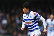 Ji-Sung Park of Queens Park Rangers runs with the ball during the Barclays Premier League match between Queens Park Rangers and Tottenham Hotspur at Loftus Road on January 12, 2013 in London, England.