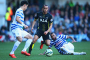 Sandro (R) and Yoon Suk-Young of QPR foil Andros Townsend of Spurs during the Barclays Premier League match between Queens Park Rangers and Tottenham Hotspur at Loftus Road on March 7, 2015 in London, England.