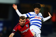 James Morrison of West Bromwich Albion battles for the ball with Ji-Sung Park of Queens Park Rangers during the FA Cup with Budweiser Third Round match between Queens Park Rangers and West Bromwich Albion at Loftus Road on January 5, 2013 in London, England.
