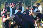 (L-R) Darius Boyd, Greg Inglis and Johnathan Thurston are seen participating in pad work during a Queensland Maroons State of Origin training session at Sanctuary Cove on May 25, 2014 at the Gold Coast, Australia.