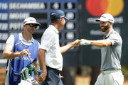 Dustin Johnson and Matt Kuchar Photos Photo