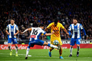 Luis Suarez of FC Barcelona competes for the ball with Javi Lopez of RCD Espanyol during the Liga match between RCD Espanyol and FC Barcelona at RCDE Stadium on January 04, 2020 in Barcelona, Spain.