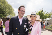 Joan Collins and Percy Gibson attend the RHS Chelsea Flower Show 2019 press day at Chelsea Flower Show on May 20, 2019 in London, England.