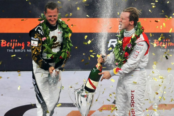 Race of Champions winner Sweden's Mattias Ekstrom (R) celebrates with runner up Michael Schumacher (L) of Germany after the Race of Champions Beijing 2009 at Beijing National Stadium on November 4, 2009 in Beijing, China.
