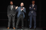 (L-R) Screenwriter Peter Fellows, actor Armando Iannucci and producer Kevin Loader receive the award for Best Comedy for 'Death of Stalin', on stage during the Rakuten TV EMPIRE Awards 2018 at The Roundhouse on March 18, 2018 in London, England.