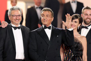 "Victor Hadida, Sylvester Stallone and Paz Vega attend the screening of ""Rambo - First Blood"" during the 72nd annual Cannes Film Festival on May 24, 2019 in Cannes, France."