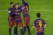 Lionel Messi (2ndL) of FC Barcelona celebrates scoring their third goal with teammates Neymar JR. (L), Gerard Pique (2ndR) and Luis Suarez (R) during the La Liga match between Rayo Vallecano de Madrid and FC Barcelona at Estadio de Vallecas on March 3, 2016 in Madrid, Spain.