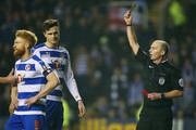 Jake Cooper of Reading (2R) is shown a red card by referee Mike Dean and is sent off during the Emirates FA Cup sixth round match between Reading and Crystal Palace at Madejski Stadium on March 11, 2016 in Reading, England.