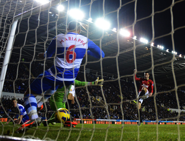 Robin van Persie of Manchester United sees his shot cross the line despite being cleared by Adrian Mariappa of Reading during the Barclays Premier League match between Reading and Manchester United at Madejski Stadium on December 1, 2012 in Reading, England.
