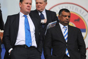QPR Chief Executive Philip Beard (L) and Tony Fernandes (R), owner of QPR look on prior to the Barclays Premier League match between Reading and Queens Park Rangers at the Madejski Stadium on April 28, 2013 in Reading, England.