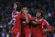 Cristiano Ronaldo of Real Madrid CF (2ndL) celebrates with his teammate, Pepe (C), Marcelo Vieira and Sergio Ramos (L) after scoring his team's third goal during the La Liga match between Real Betis Balompie and Real Madrid CF at Estadio Benito Villamarin on March 10, 2012 in Seville, Spain.
