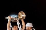 (L-R) Real Madrid player Iker Casillas lift the trophy next Sergio Ramos as they celebrate the victory on the UEFA Champions League Final match against Club Atletico de Madrid at Cibeles Square on May, 25, 2014 in Madrid, Spain. Real Madrid CF has achieved their 10th European Cup at Lisbon, 12 years after their last one.