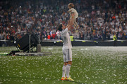 Real Madrid player Gareth Bale plays with his daughter during the Real Madrid celebration the day after winning the UEFA Champions League final at Santiago Bernabeu Stadium on May 25, 2014 in Madrid, Spain. Real Madrid CF achieves their tenth European Cup at Lisbon at Lisbon 12 years later.