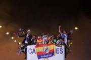 Real Madrid players Sergio Ramos, Cristiano Ronaldo, Pepe, Jesus Fernandez, Marcelo and Angel Di Maria arrive on a bus to celebrate their victory In the UEFA Champions League Final match against Club Atletico de Madrid at Cibeles Square on May, 24, 2014 in Madrid, Spain. Real Madrid CF has achieved their 10th European Cup at Lisbon, 12 years after their last one.