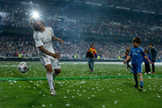 Marcelo of Real Madrid CF plays with kids on the pitch during the Real Madrid celebration the day after winning the UEFA Champions League Final at Santiago Bernabeu stadium on May 25, 2014 in Madrid, Spain.