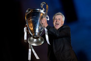 Head coach Carlo Ancelotti of Real Madrid CF holds the UEFA Champions League cup celebrating their victory on the UEFA Champions League Final match against Club Atletico de Madrid at Cibeles square on the early morning of May, 25, 2014 in Madrid, Spain. Real Madrid CF achieves their 10th European Cup at Lisbon 12 years later.