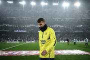 Gerard Pique of FC Barcelona walks off the pitch after the warm up prior to the Liga match between Real Madrid CF and FC Barcelona at Estadio Santiago Bernabeu on March 01, 2020 in Madrid, Spain.
