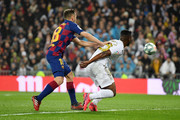 Vinicius Junior of Real Madrid is fouled by Jordi Alba of FC Barcelona during the Liga match between Real Madrid CF and FC Barcelona at Estadio Santiago Bernabeu on March 01, 2020 in Madrid, Spain.